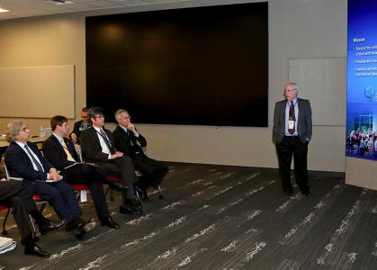 NCCS Director Jim Hack briefs Energy Secretary Moniz in EVEREST, the OLCF's scientific visualization facility.